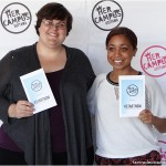 Lia and Nicole hold the #StartNow conference programs up for all to see.