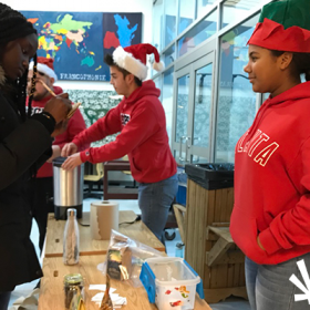 The volunteers were festive while they handed out fair trade hot chocolate and draw tickets